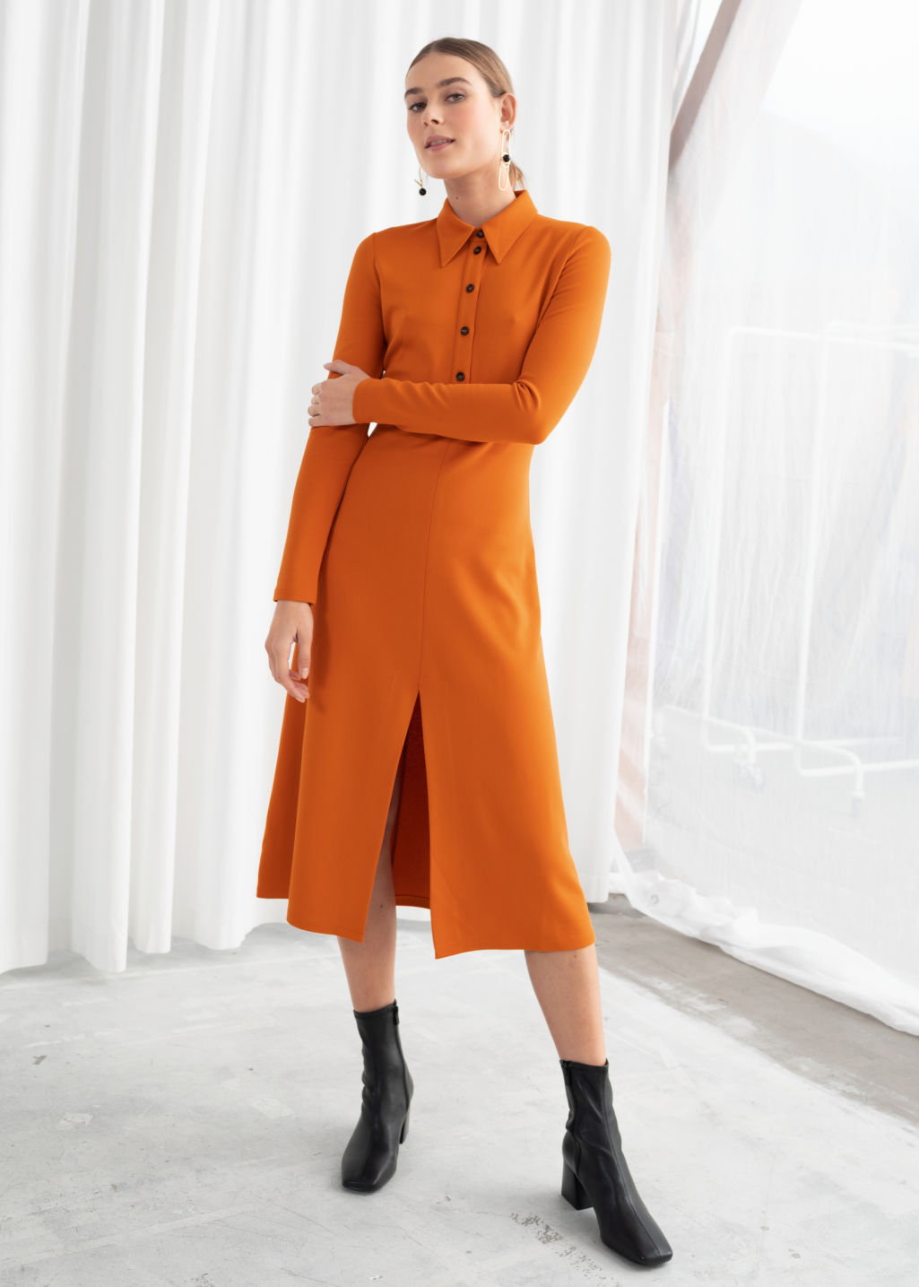 Model front image of Stories front slit midi dress in orange