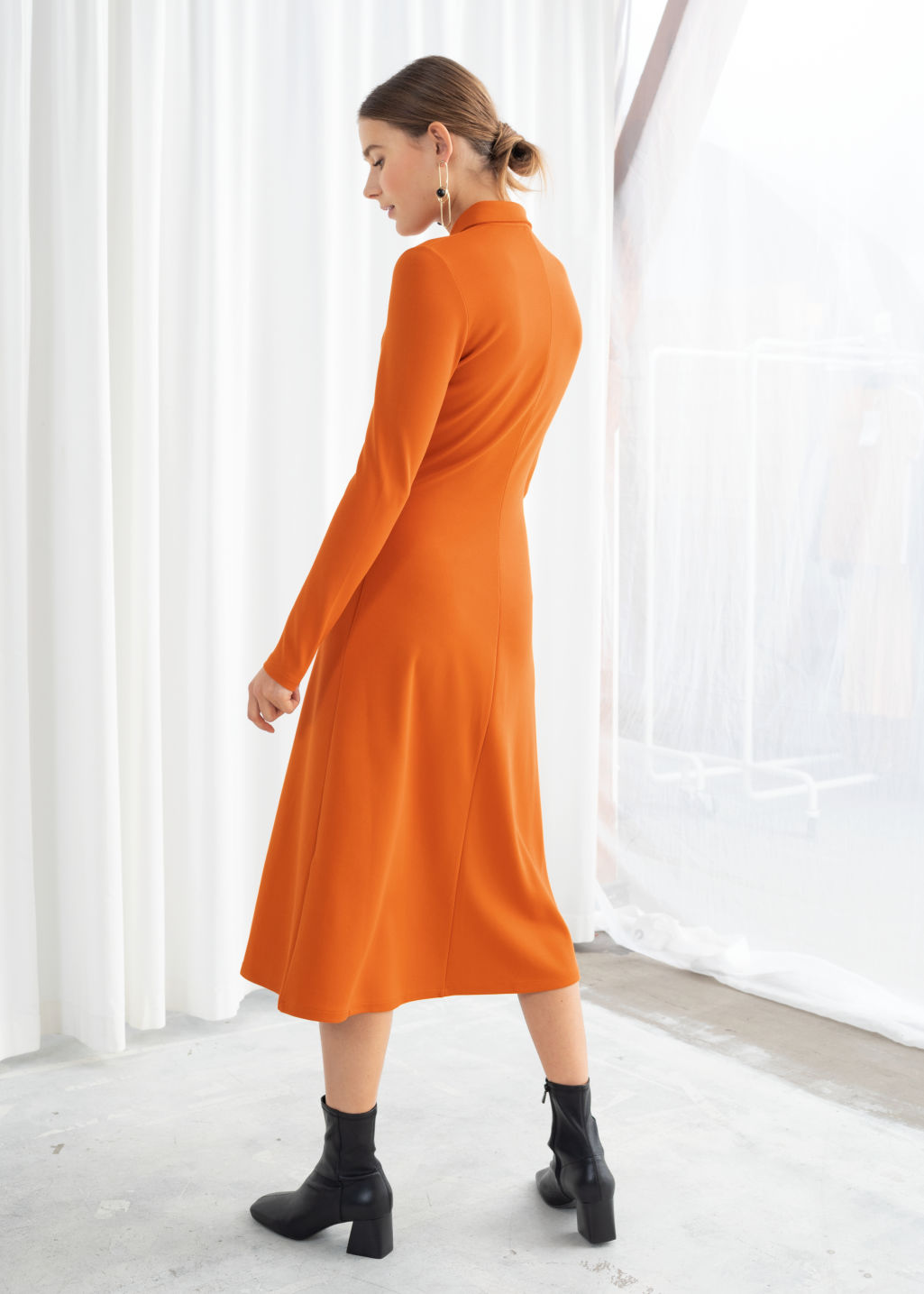 Model back image of Stories front slit midi dress in orange