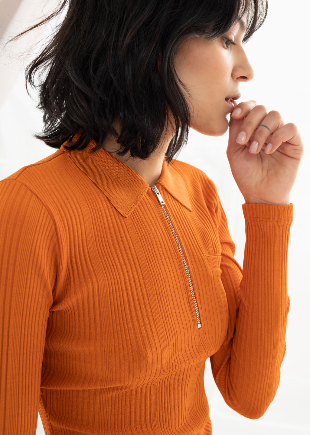 Model front image of Stories rib knit zippered polo top in orange