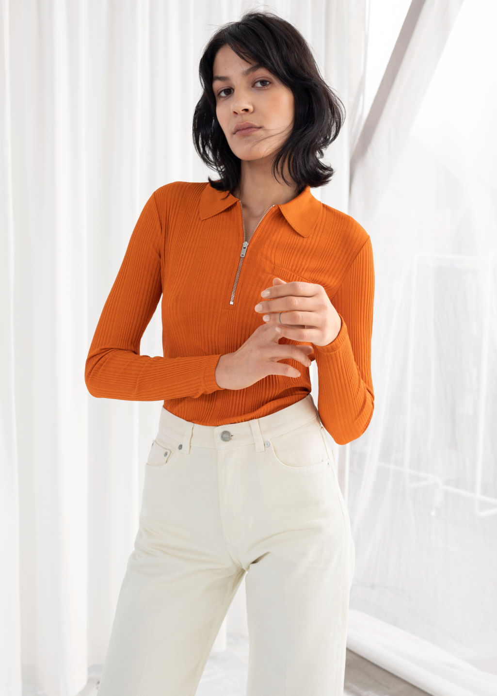 Model back image of Stories rib knit zippered polo top in orange