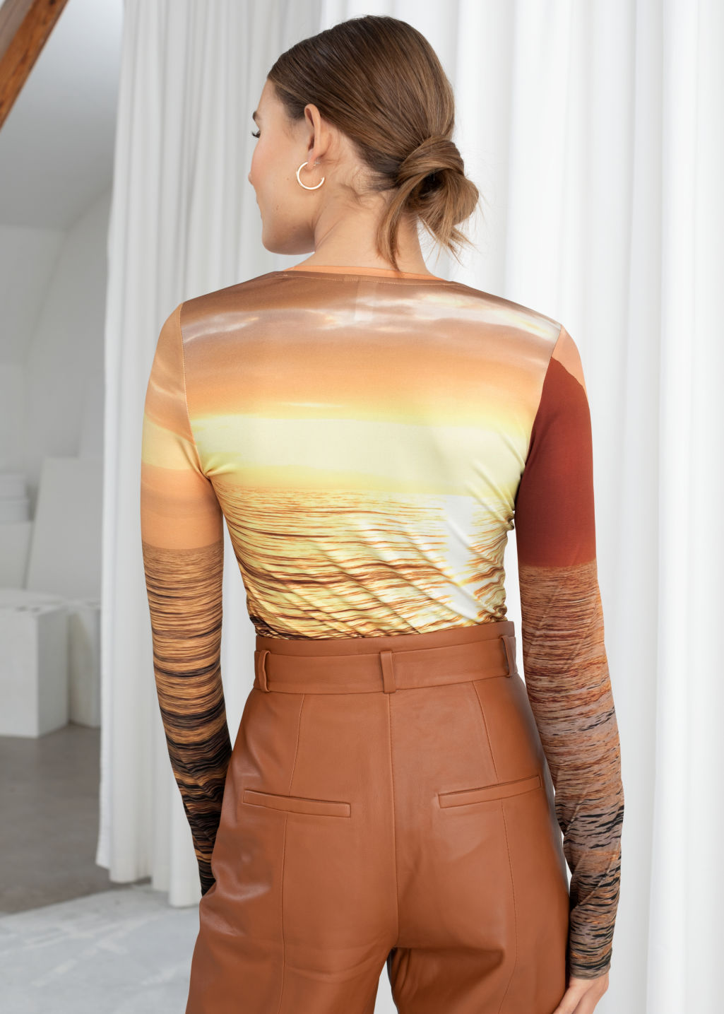 Model back image of Stories long sleeve sunset top in yellow