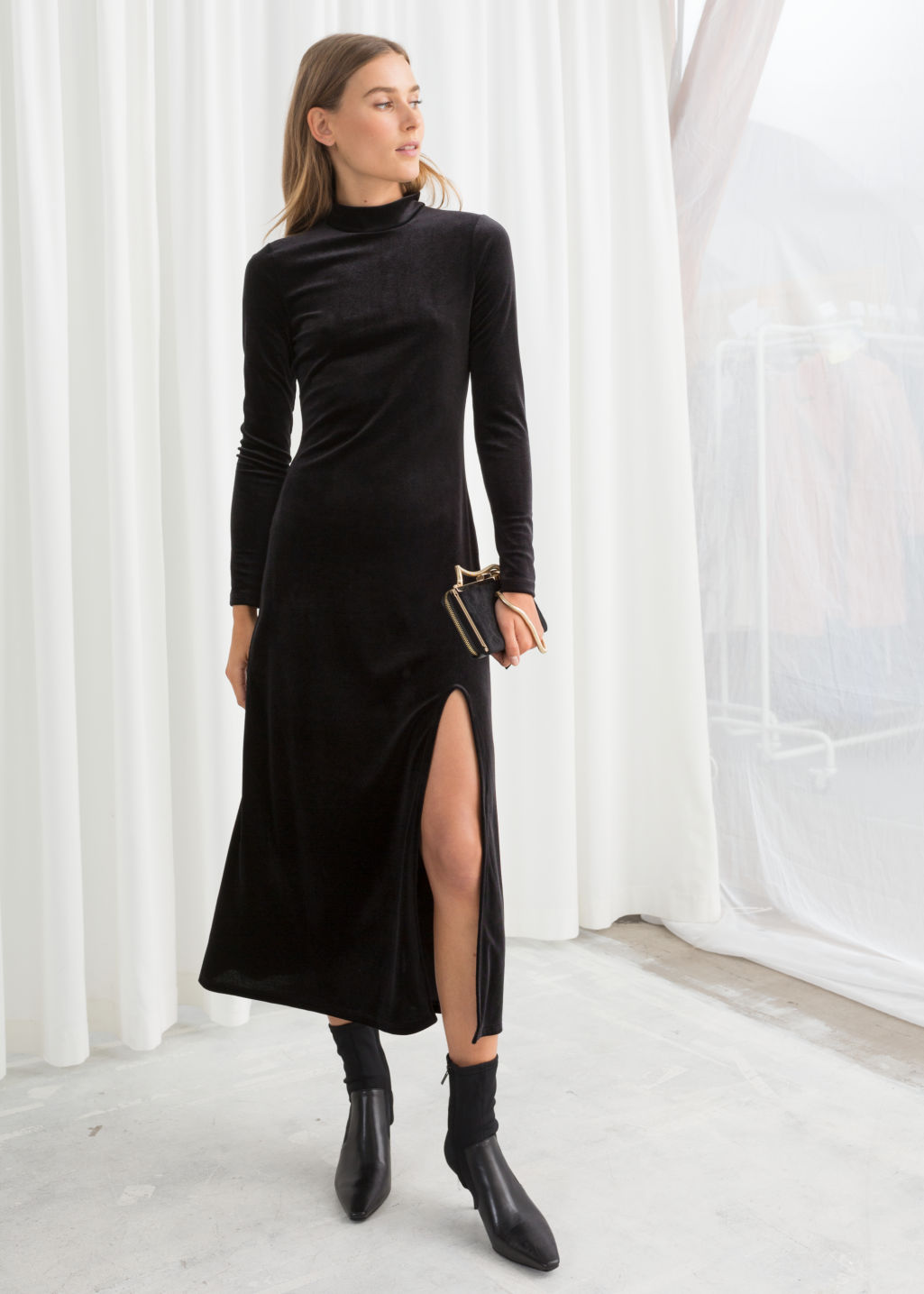 Model front image of Stories velvet turtleneck midi dress in black