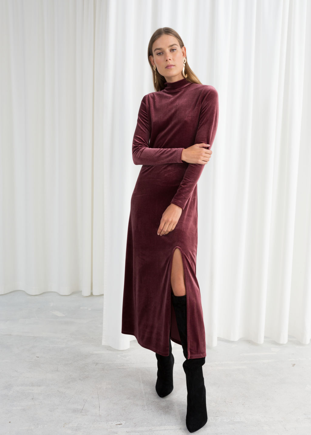 Model front image of Stories velvet turtleneck midi dress in red