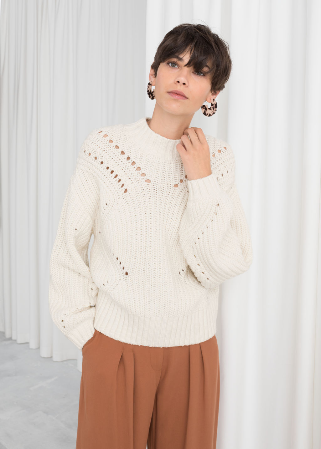 Model front image of Stories boxy cable knit sweater in white
