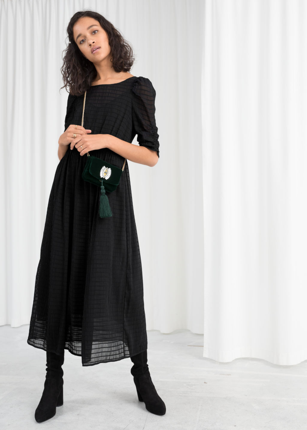 Model front image of Stories sheer ruched midi dress in black