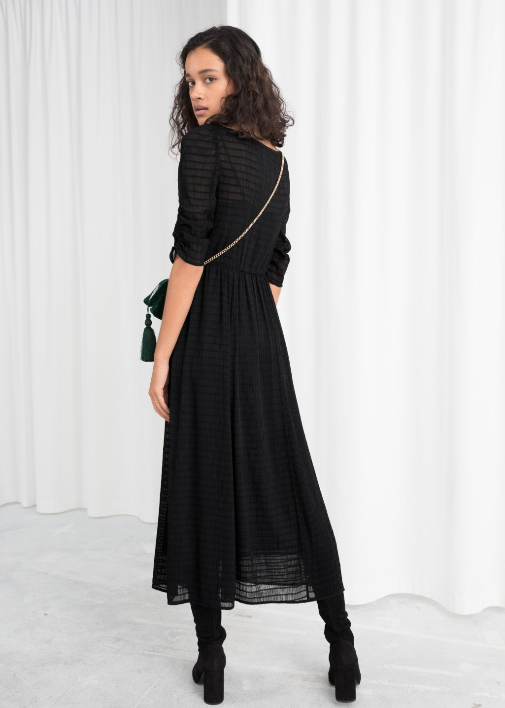 Model back image of Stories sheer ruched midi dress in black