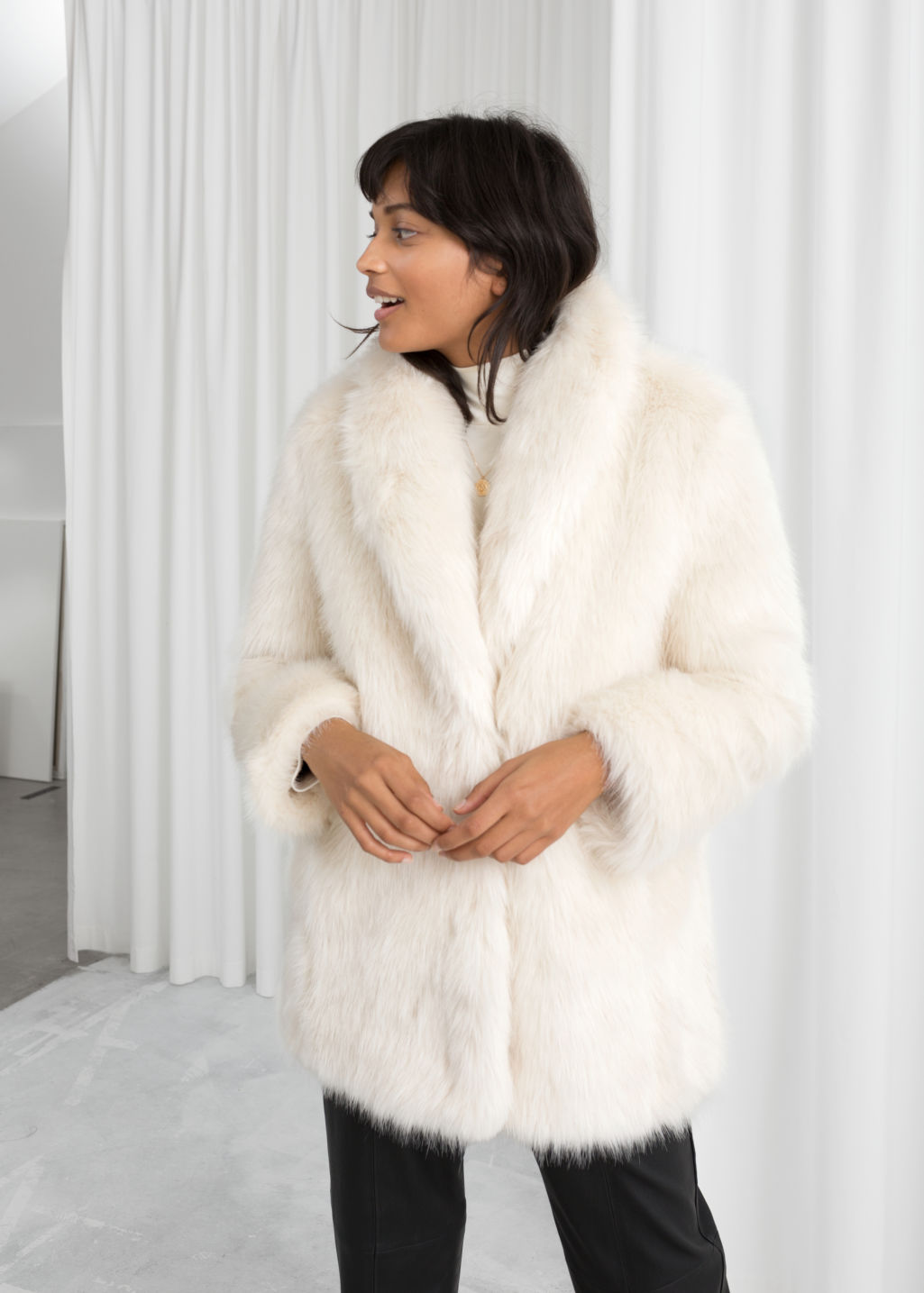 Model front image of Stories faux fur coat in white