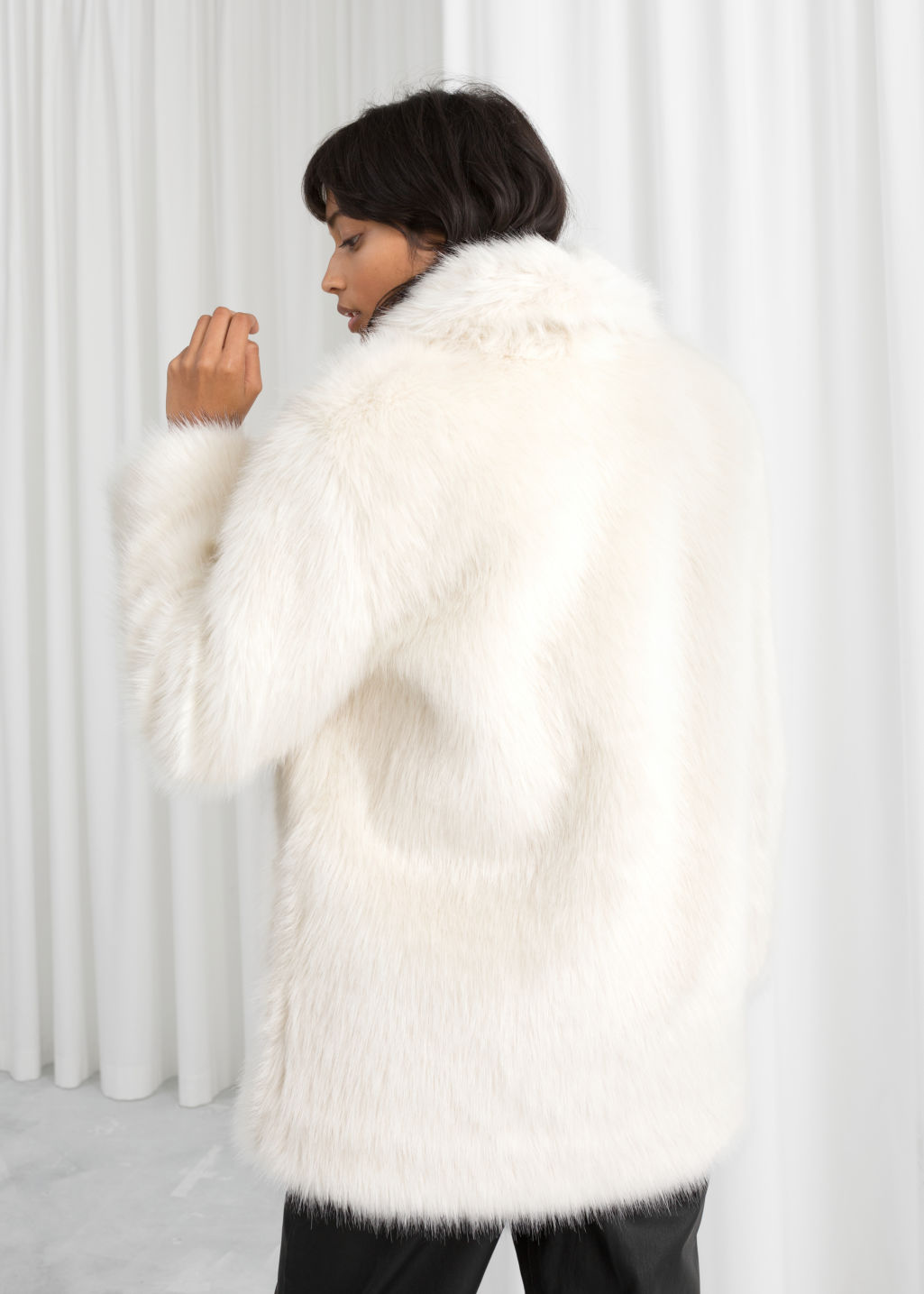 Model back image of Stories faux fur coat in white