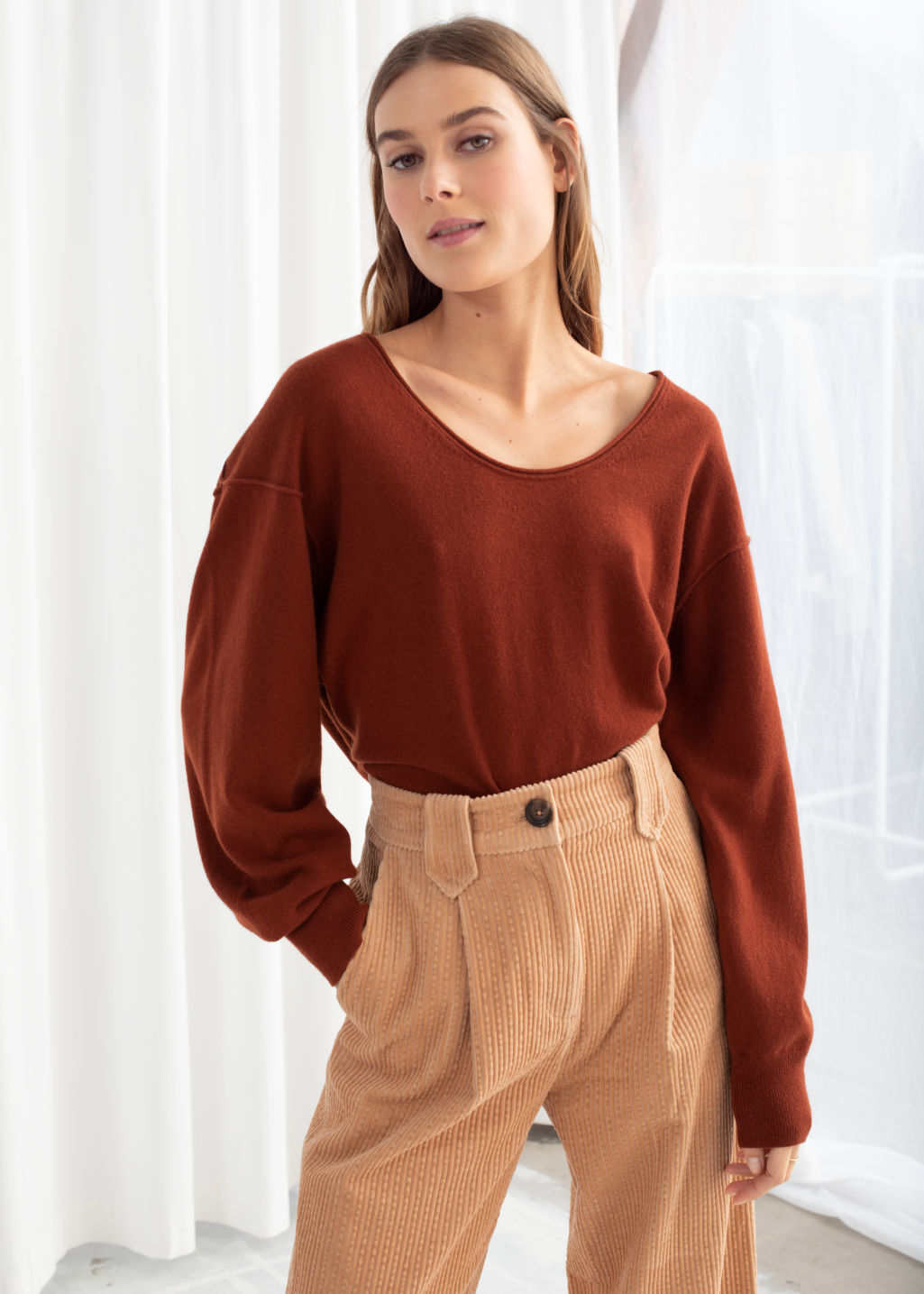 Model front image of Stories scoop neck cashmere sweater in orange