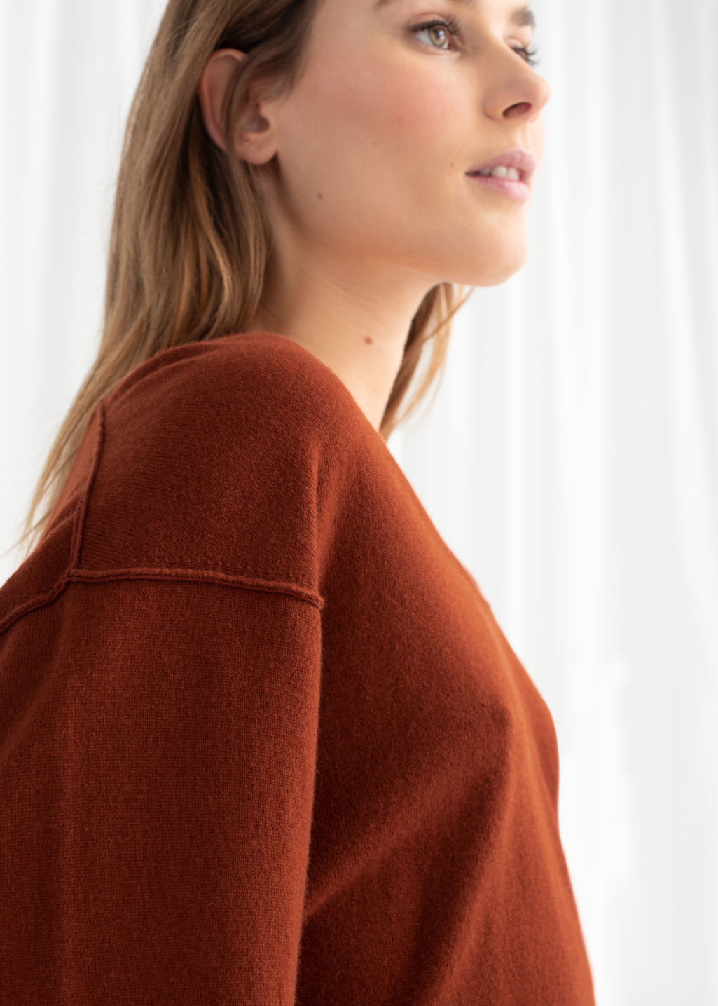 Model back image of Stories scoop neck cashmere sweater in orange
