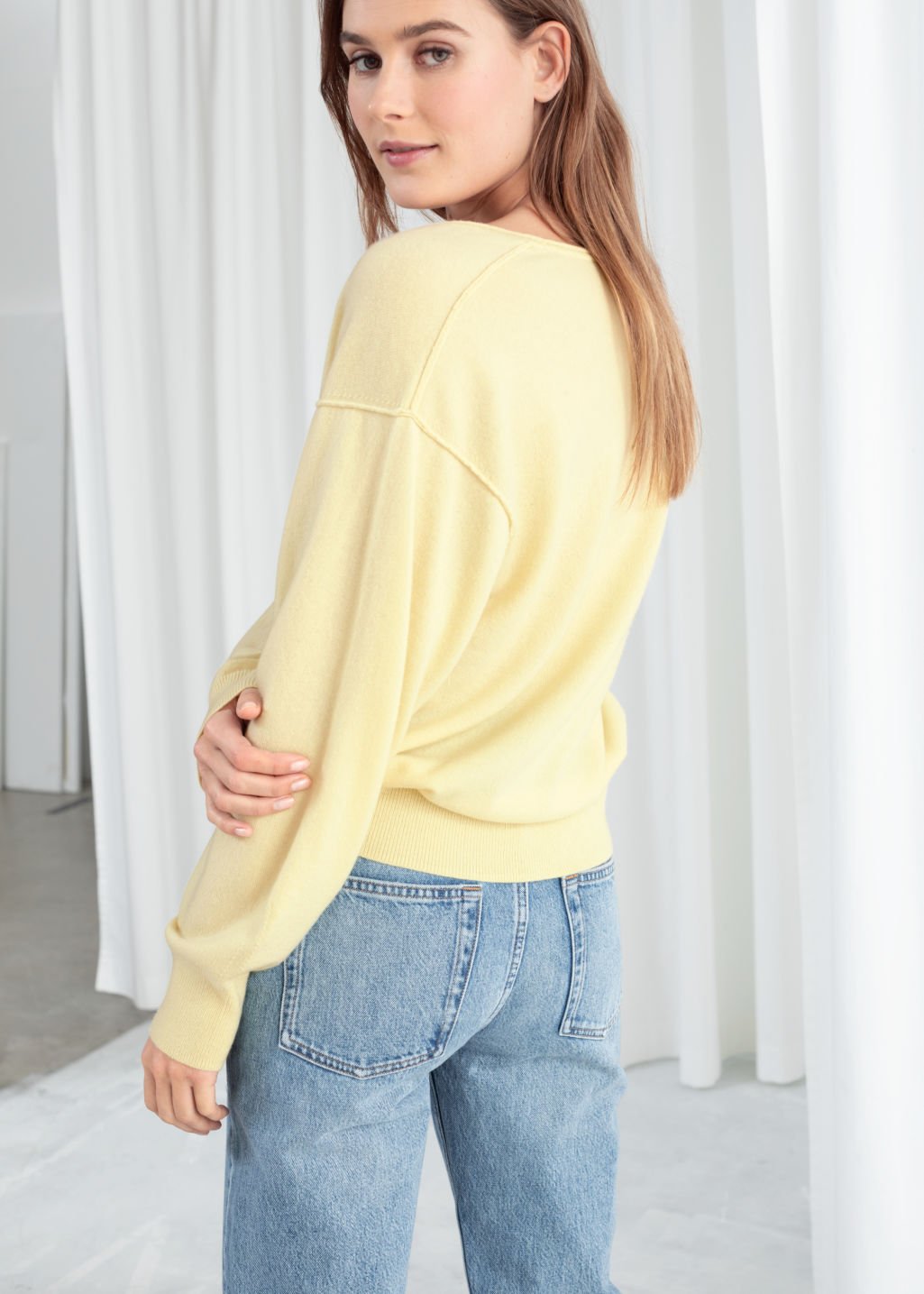 Model back image of Stories scoop neck cashmere sweater in yellow