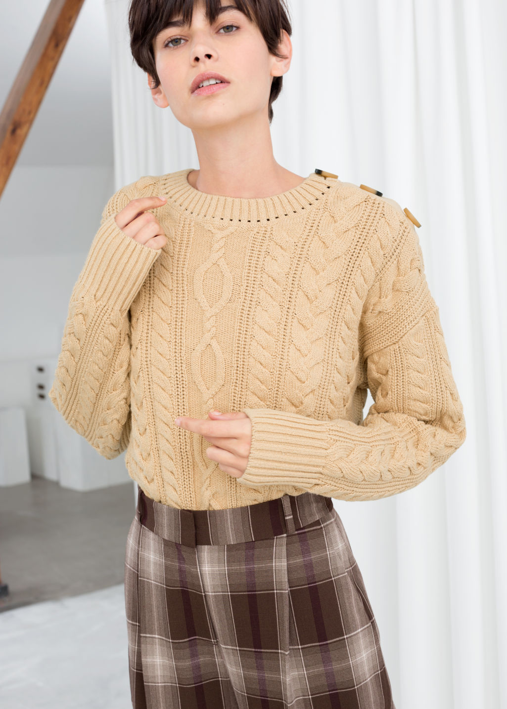 Model front image of Stories cotton cable knit sweater in beige