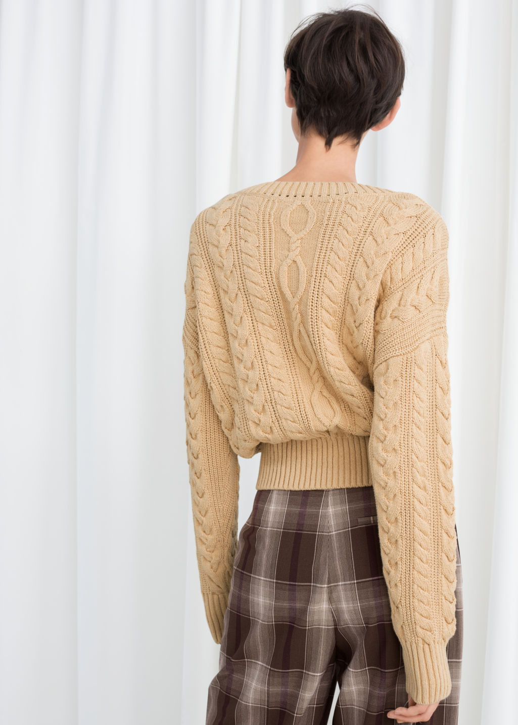 Model back image of Stories cotton cable knit sweater in beige