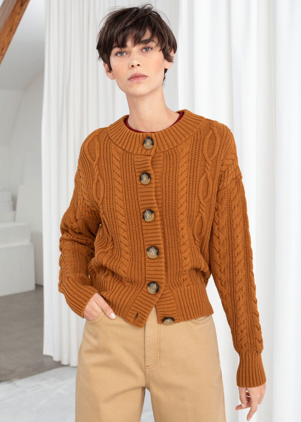 Model front image of Stories cable knit cardigan in orange