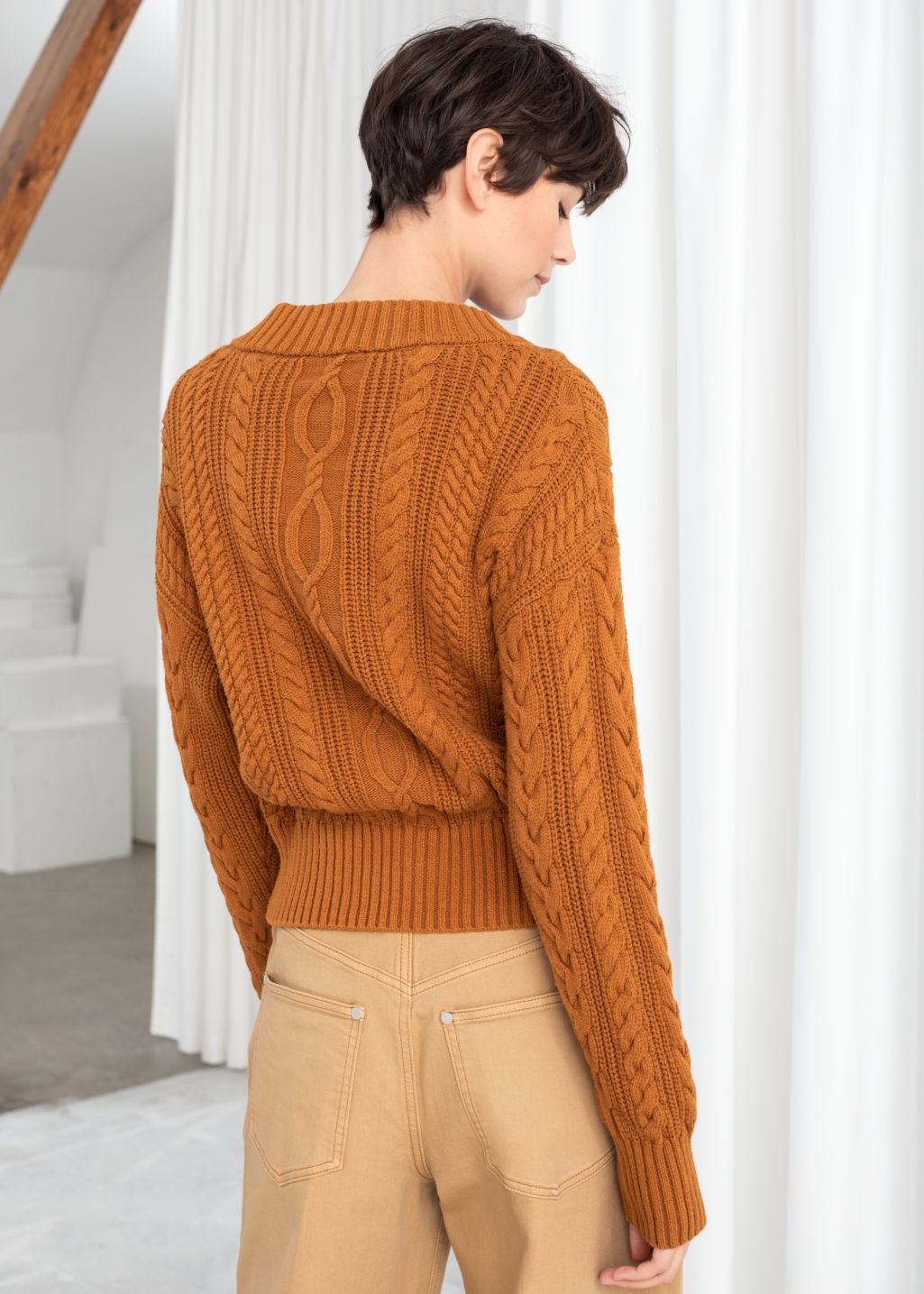 Model back image of Stories cable knit cardigan in orange