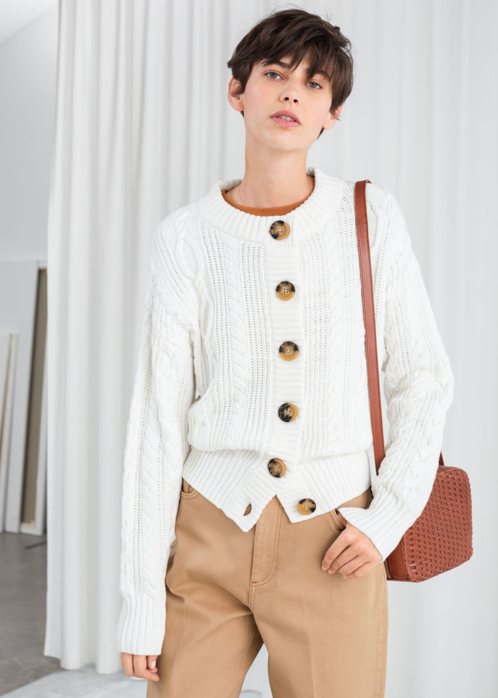 Model front image of Stories cable knit cardigan in white