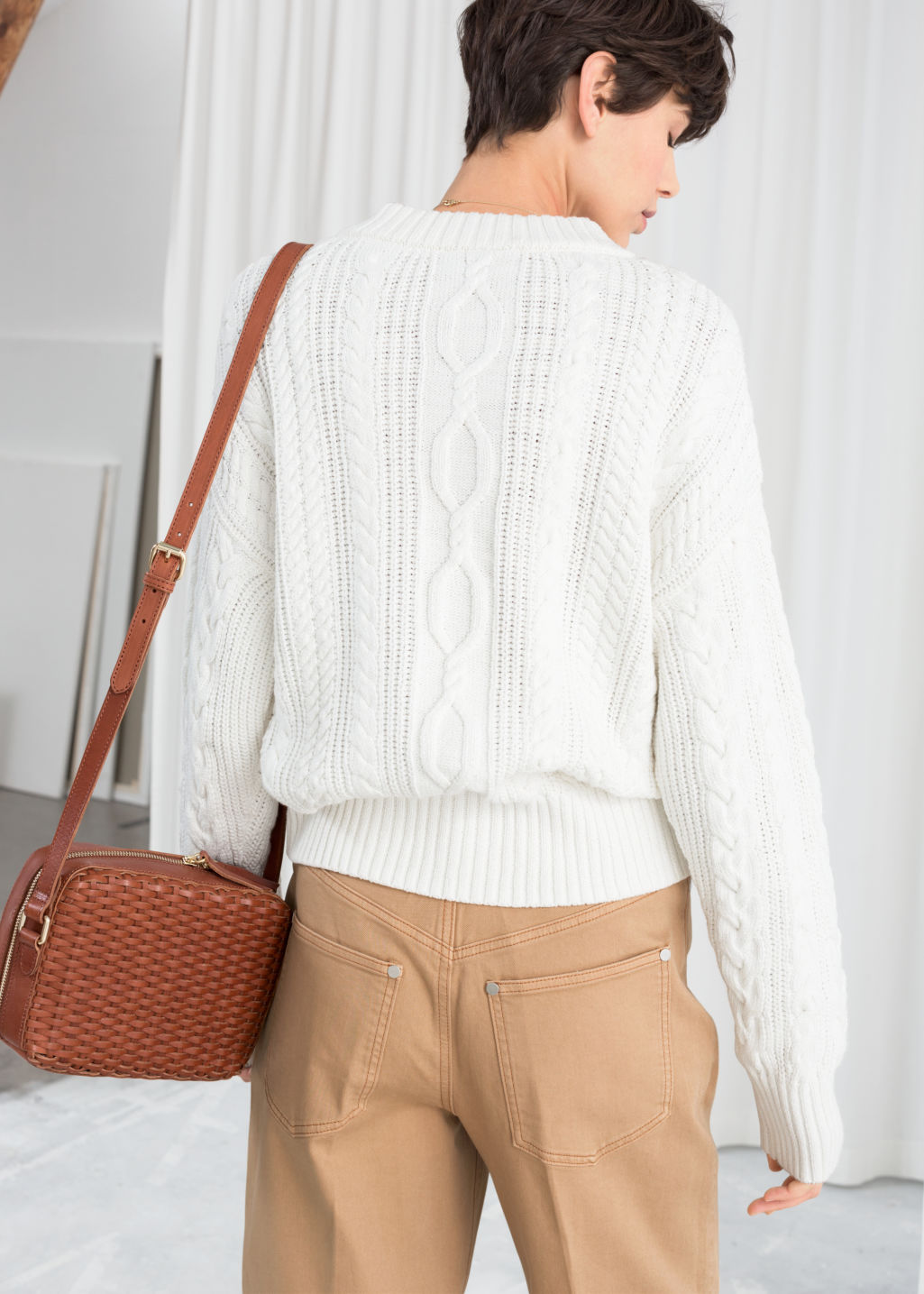 Model back image of Stories cable knit cardigan in white