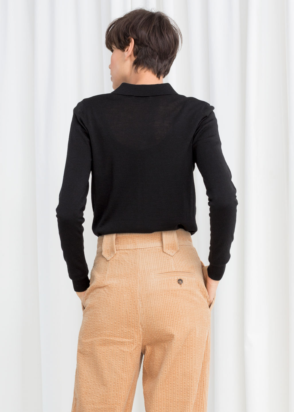 Model back image of Stories merino wool polo top in black
