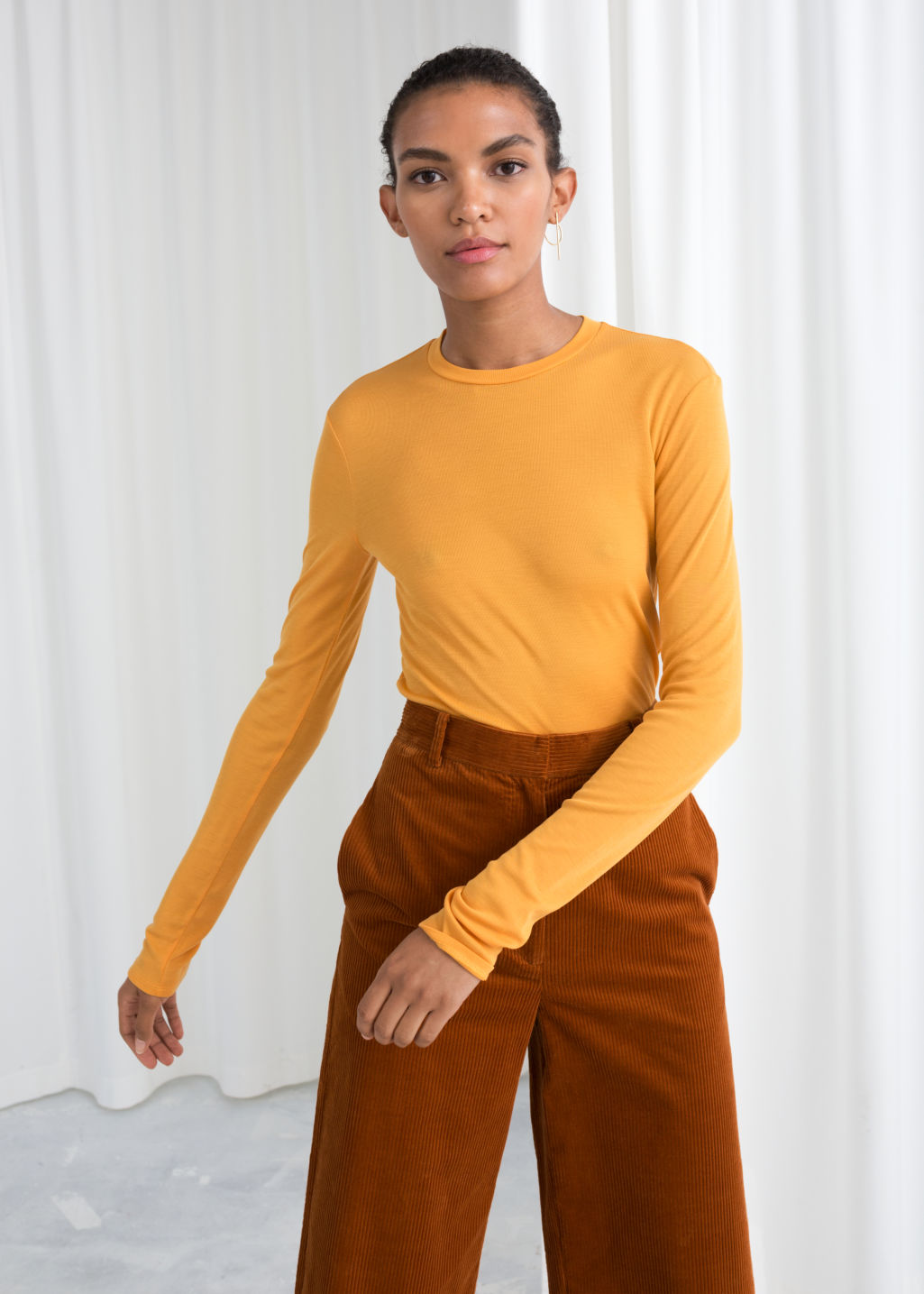 Model front image of Stories fitted ribbed top in yellow