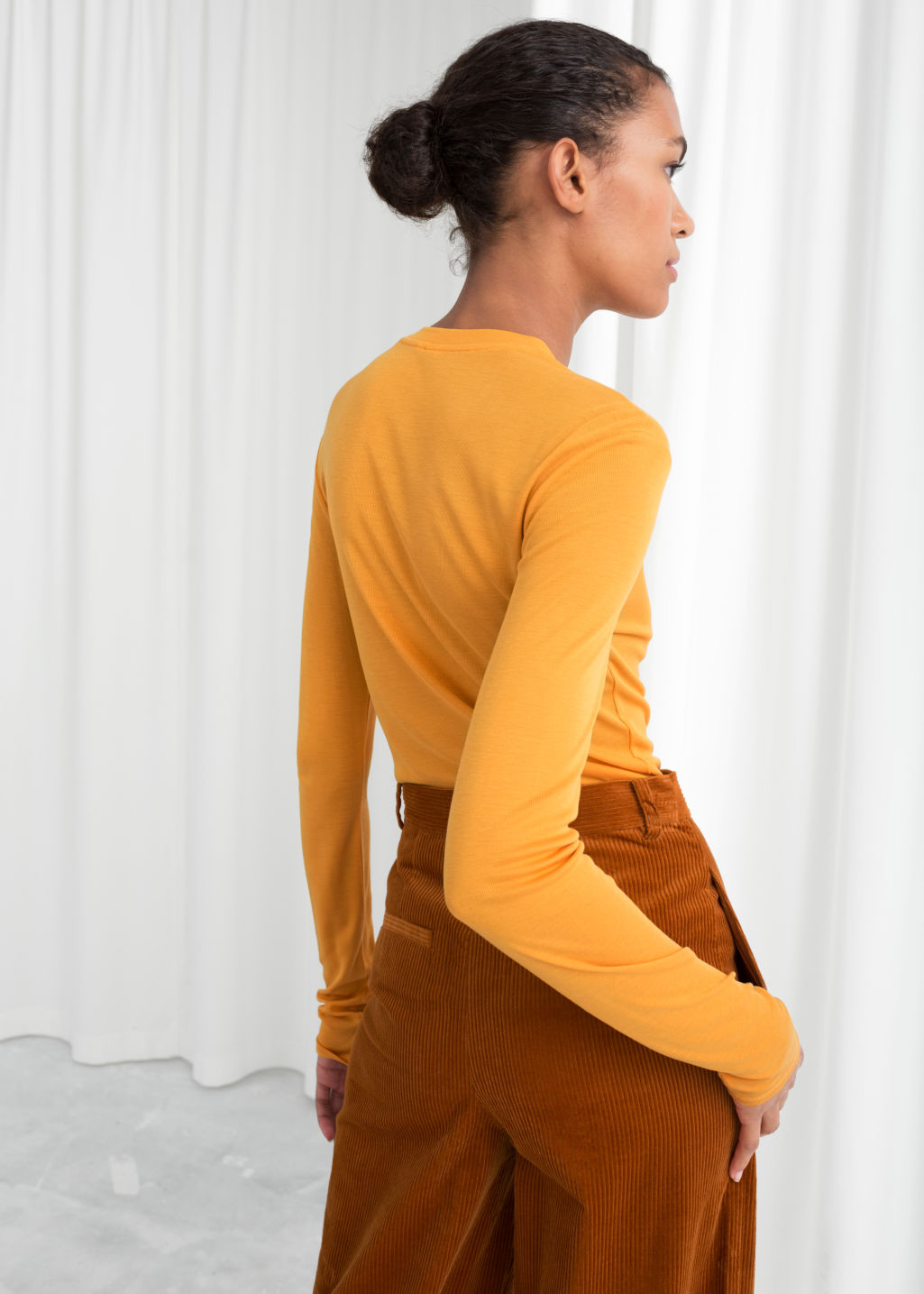 Model back image of Stories fitted ribbed top in yellow