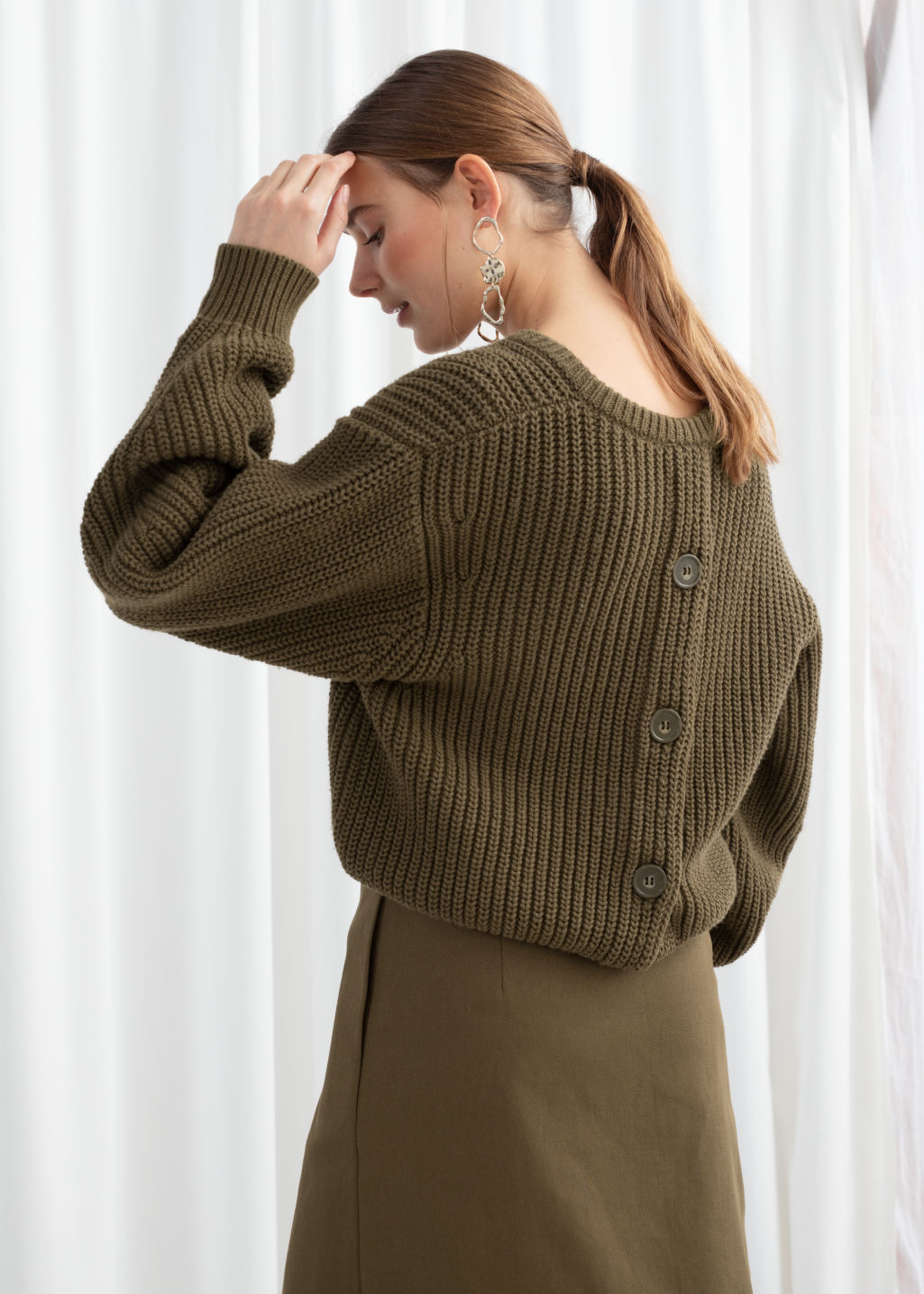 Model back image of Stories v-neck rib knit sweater in brown