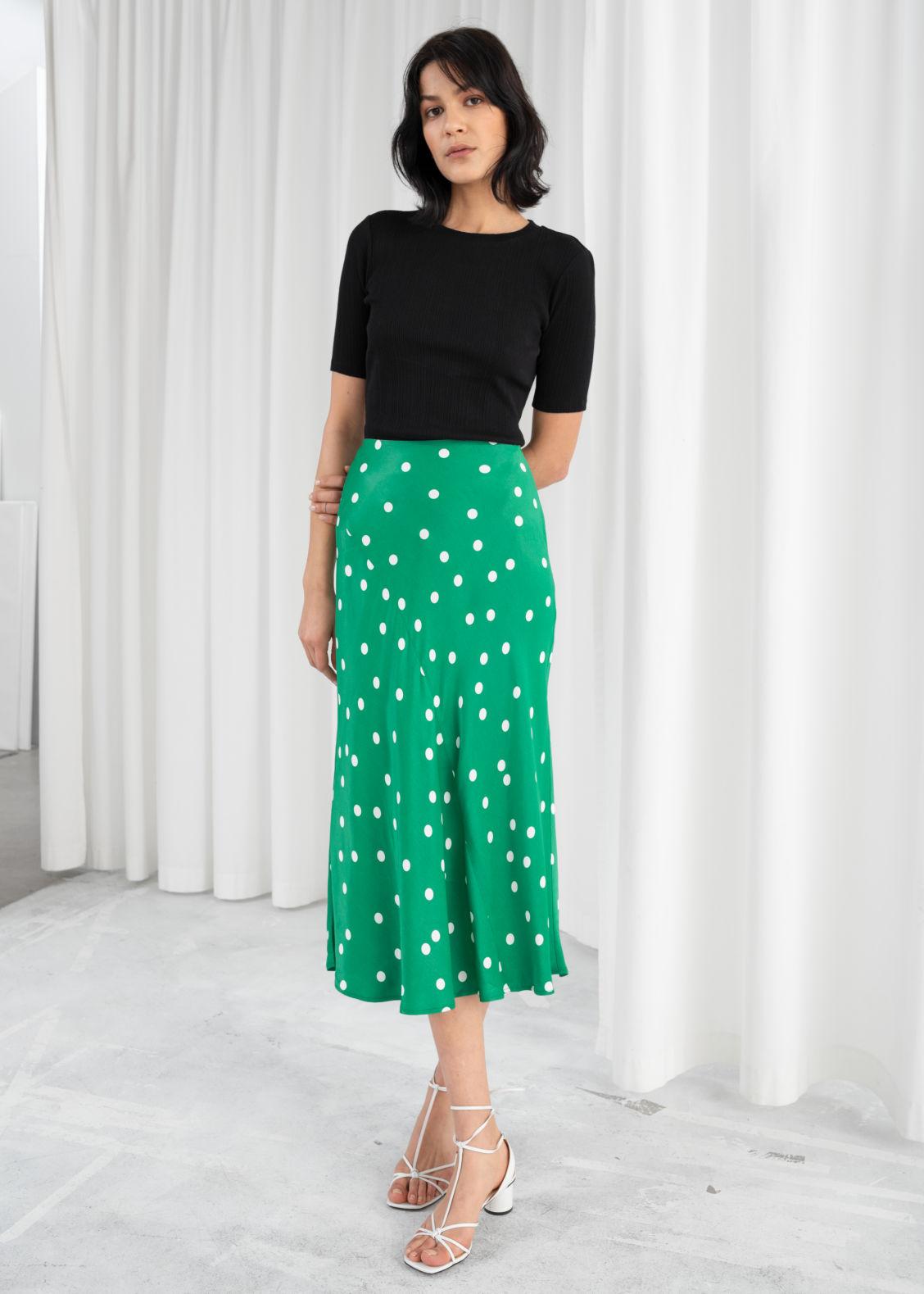 bd2e64b3a4 Model front image of Stories polka dot satin midi skirt in green