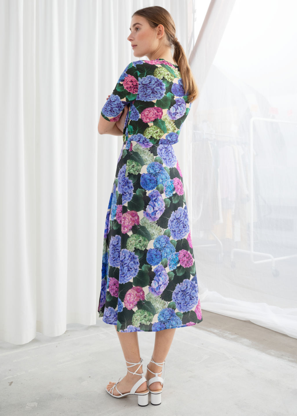 Model back image of Stories floral pleated a-line midi skirt in blue
