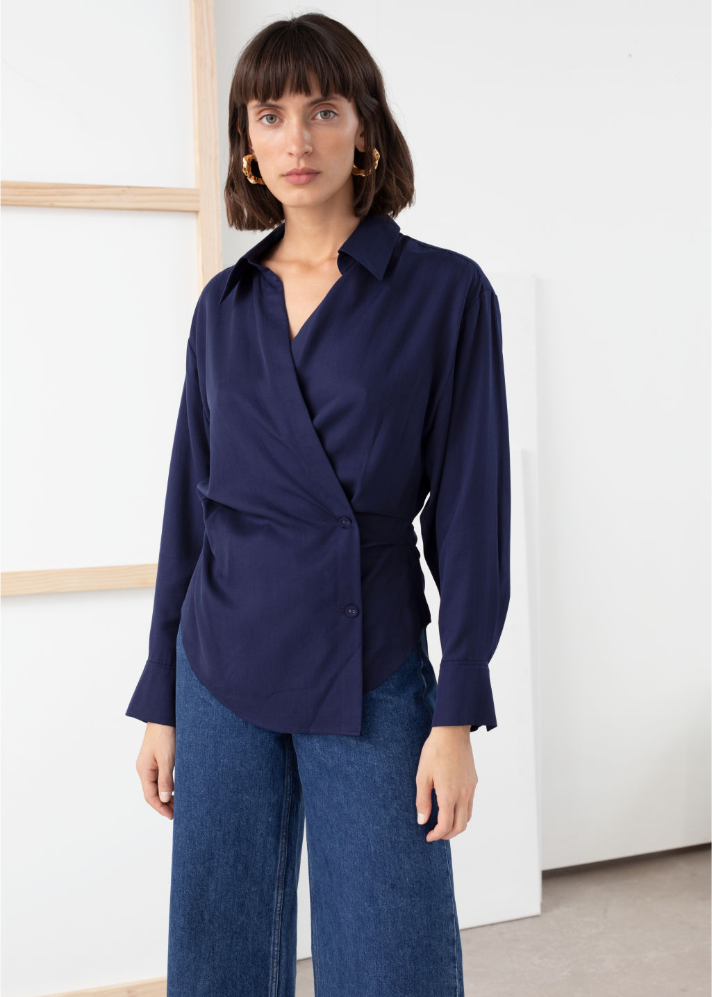 Model front image of Stories wrap duo button shirt in blue