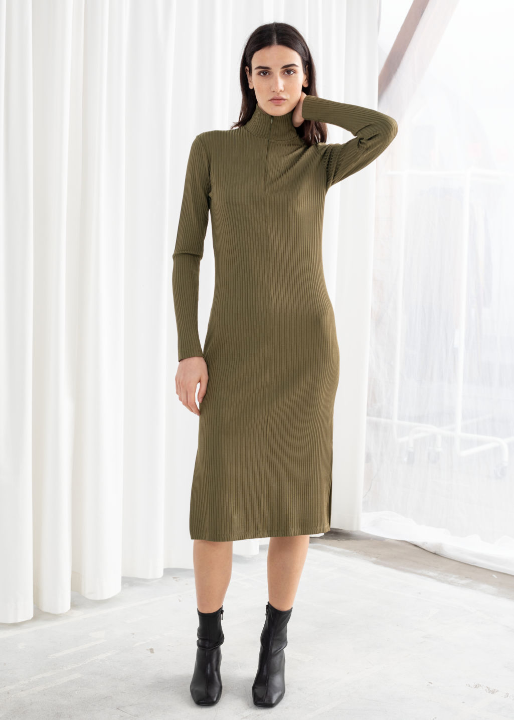 Model front image of Stories ribbed turtleneck midi dress in green