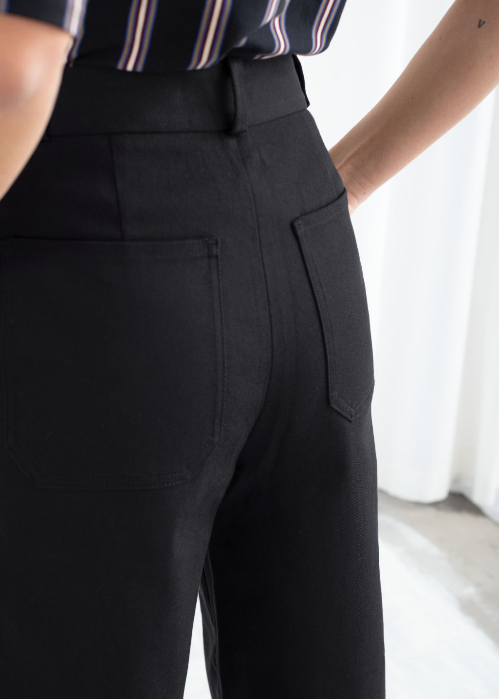 Model back image of Stories stretch cotton culotte trousers in black