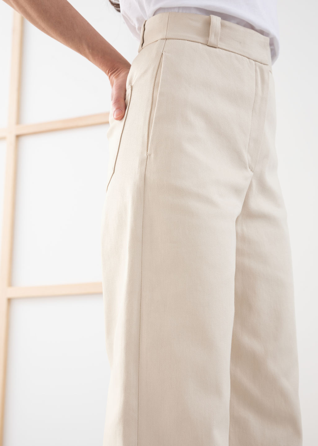 Model back image of Stories stretch cotton culotte trousers in beige