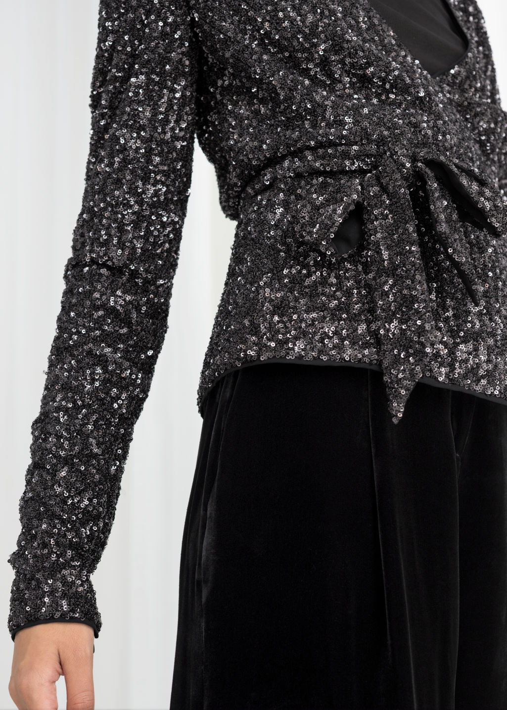 Model back image of Stories sequin wrap top  in black