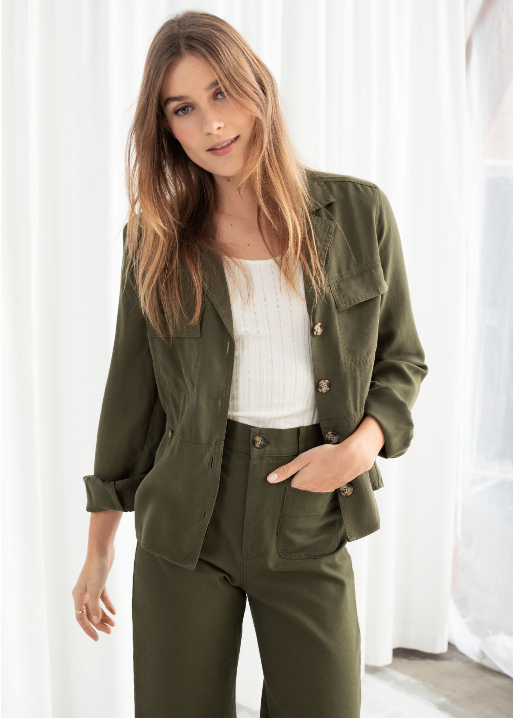 Model front image of Stories workwear overshirt jacket in green