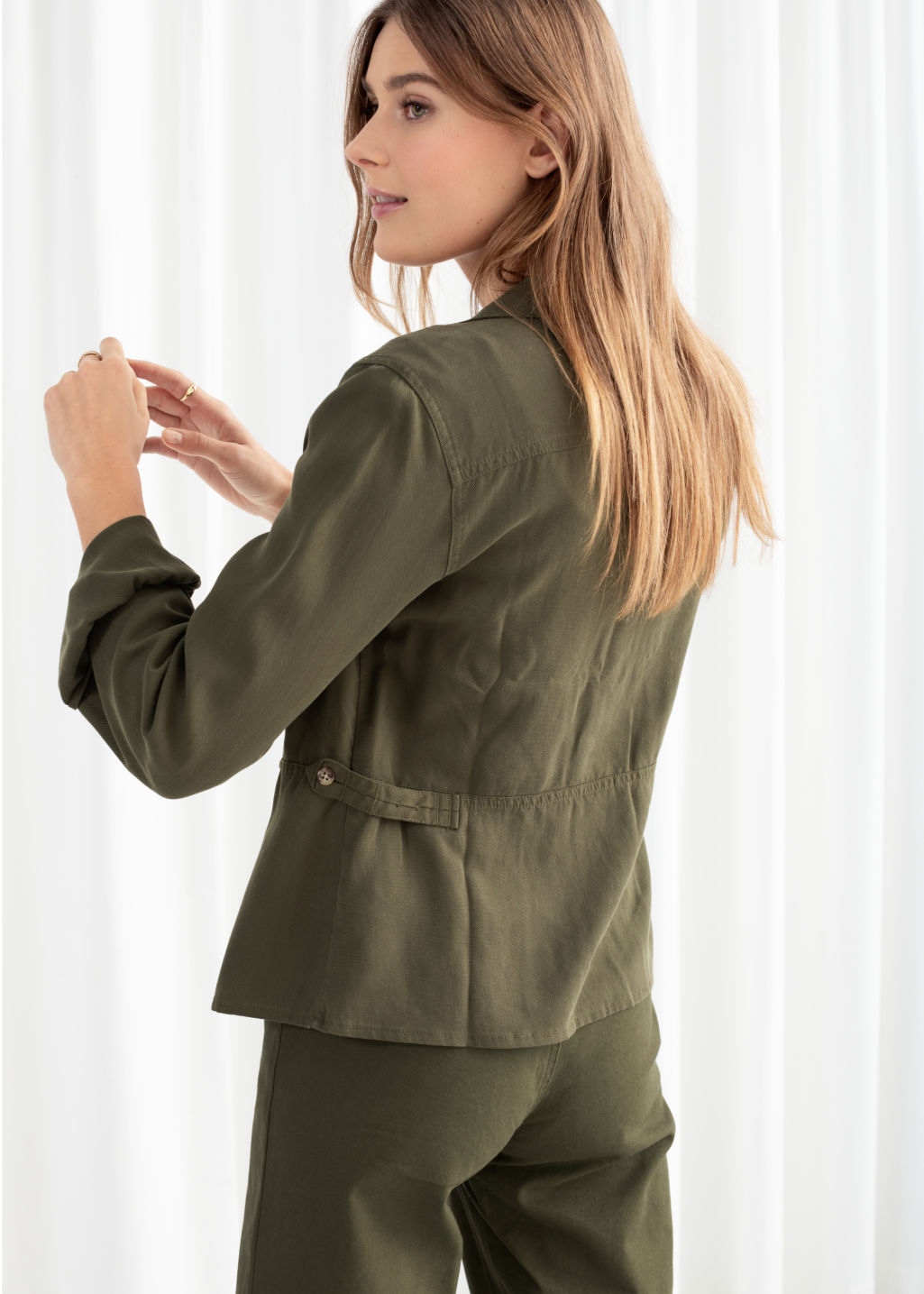 Model back image of Stories workwear overshirt jacket in green