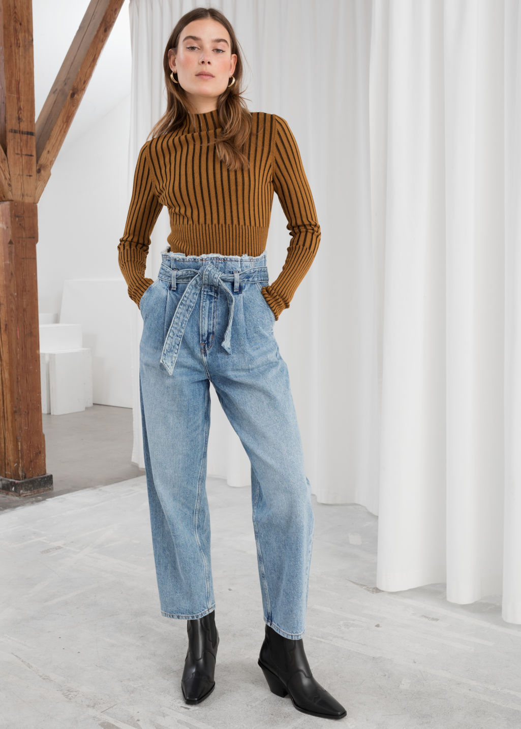 Model front image of Stories high belted organic cotton jeans in blue