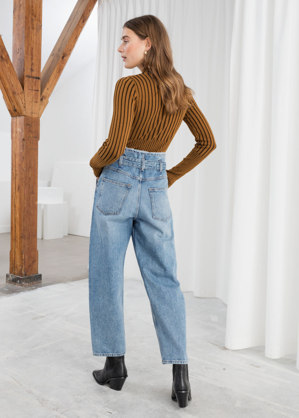 Model back image of Stories high belted organic cotton jeans in blue