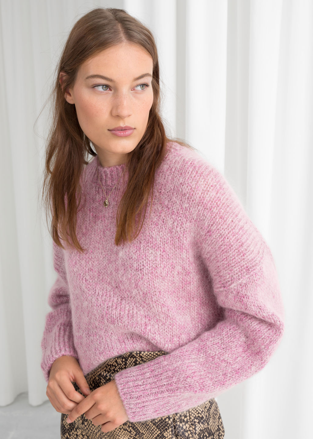Model front image of Stories boxy wool blend sweater in pink