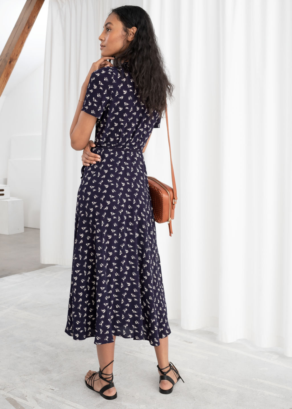 Model back image of Stories flowy wrap midi dress in blue