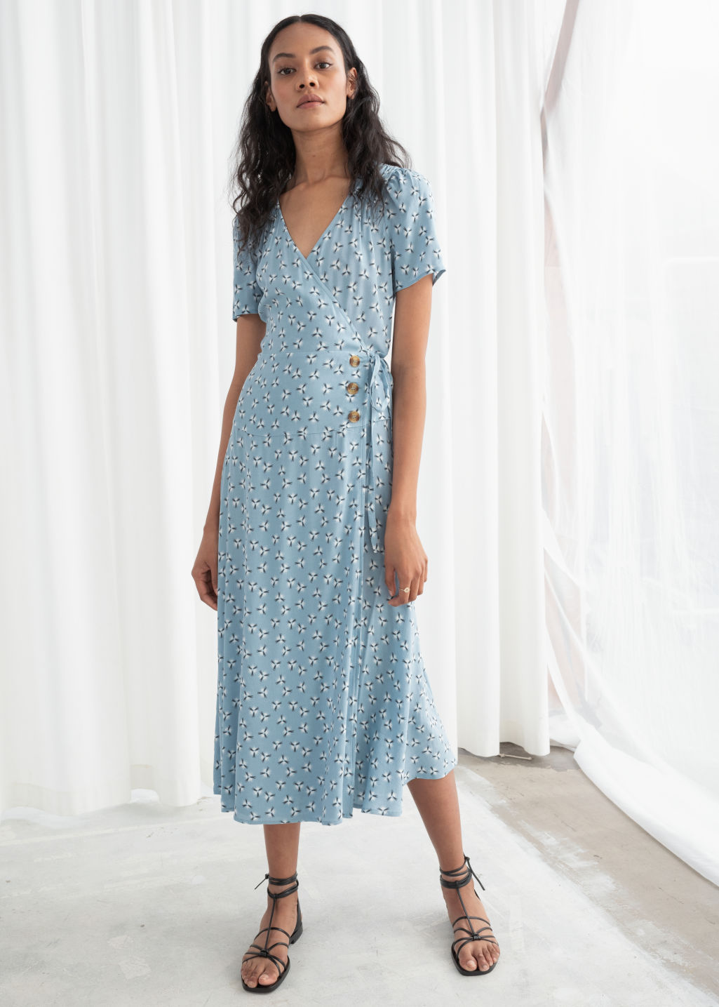 Model front image of Stories flowy wrap midi dress in turquoise