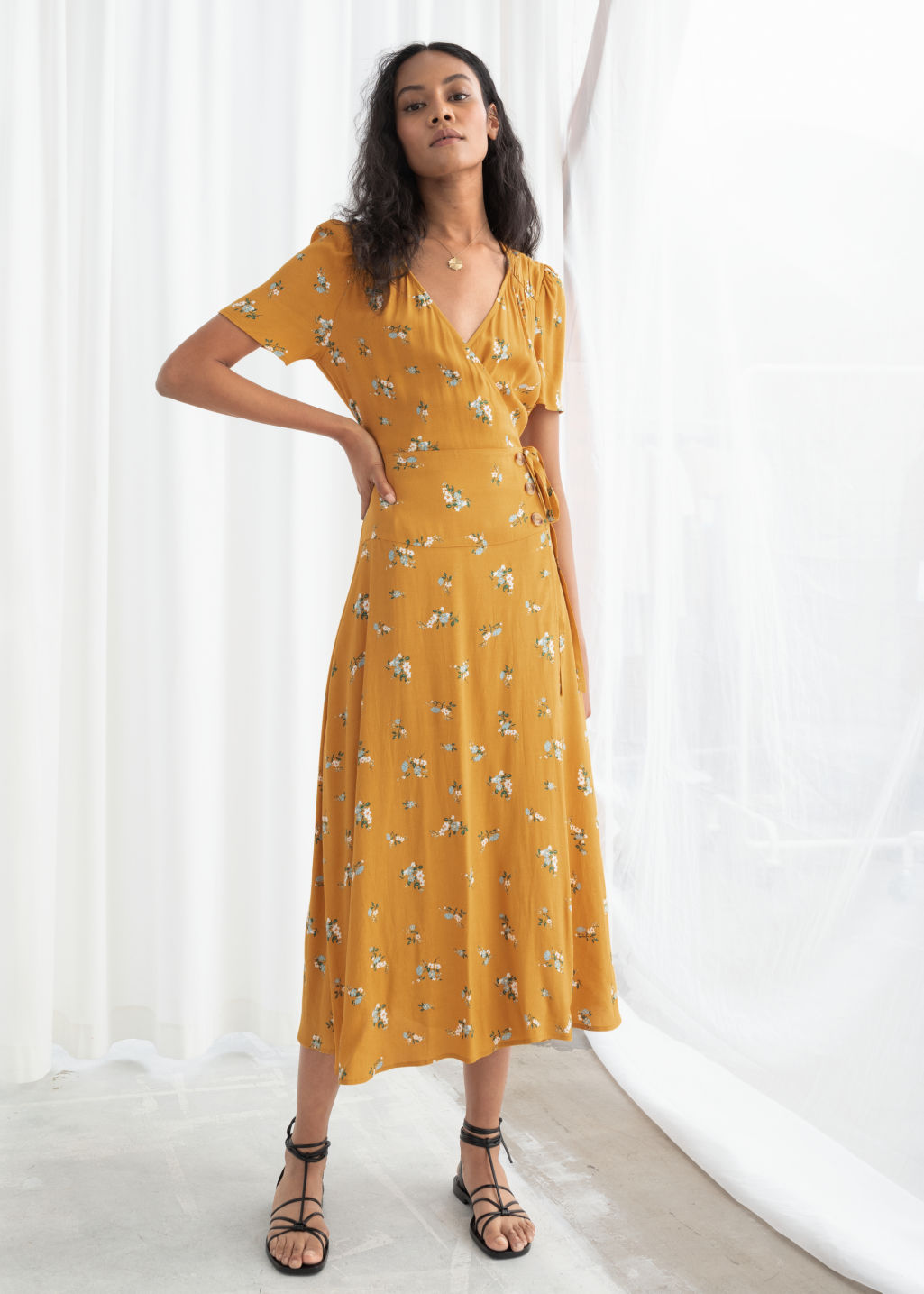 Model front image of Stories flowy wrap midi dress in yellow