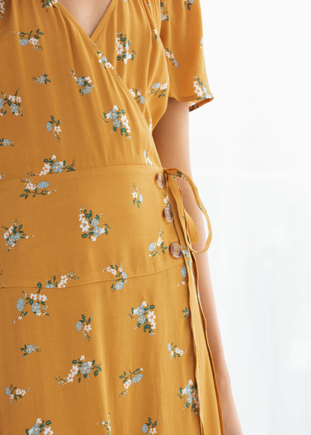 Model back image of Stories flowy wrap midi dress in yellow