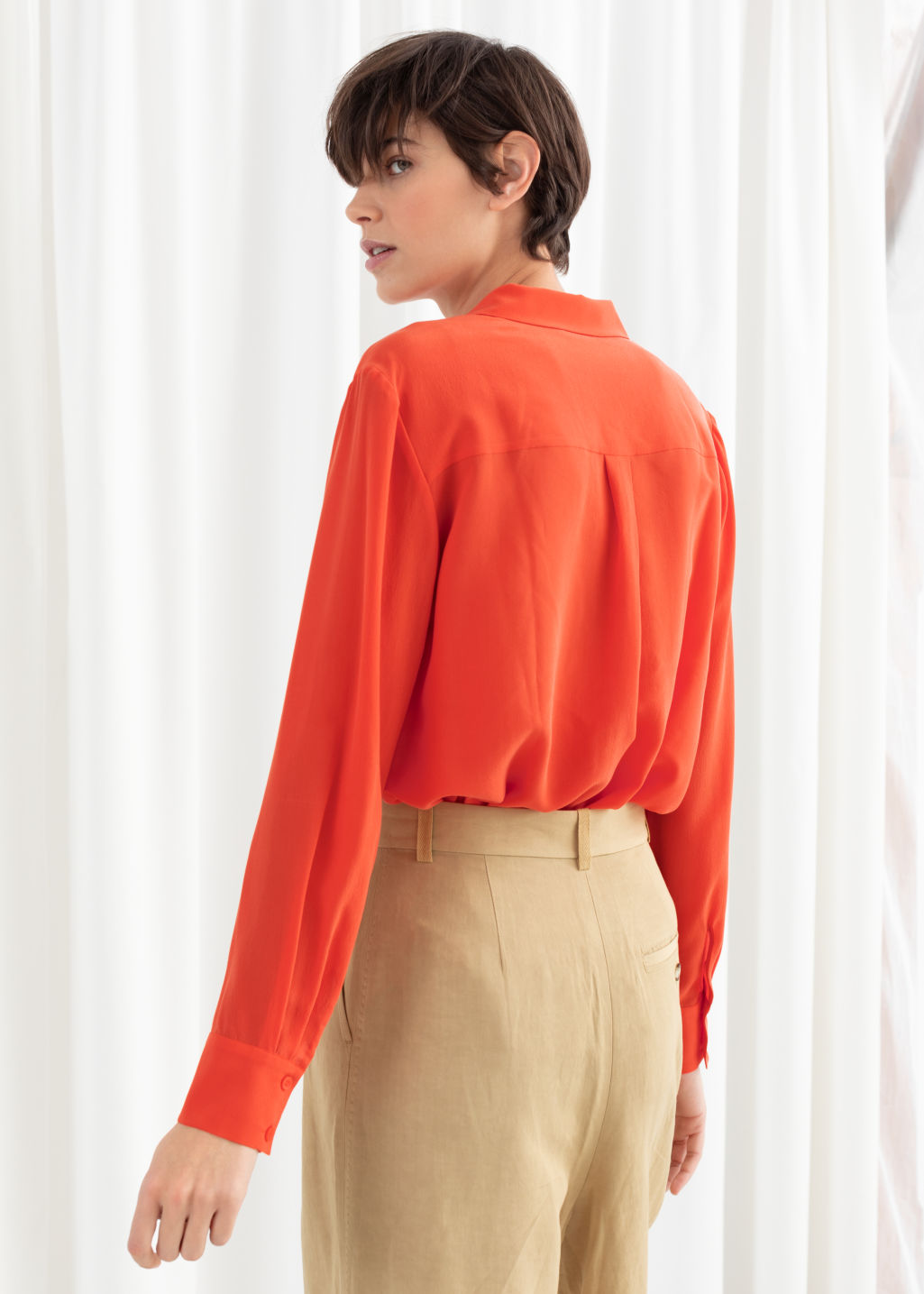 Model back image of Stories straight fit silk shirt in orange