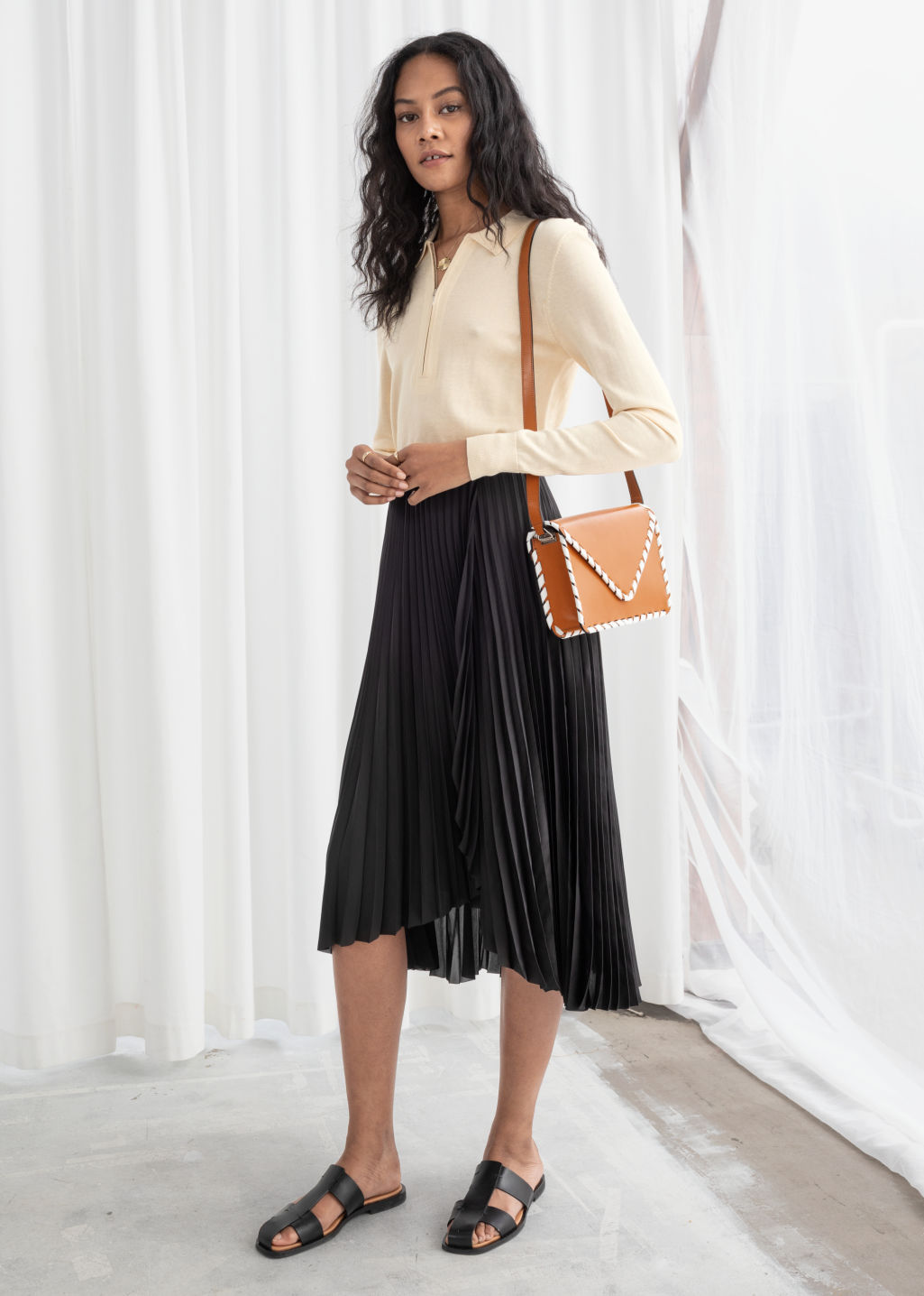 Model front image of Stories pleated wrap midi skirt in black