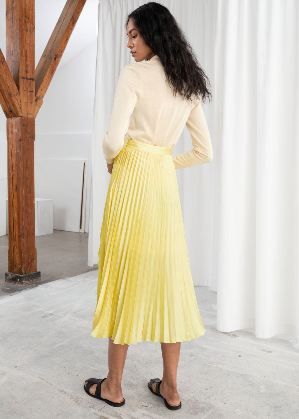 Model back image of Stories pleated wrap midi skirt in yellow