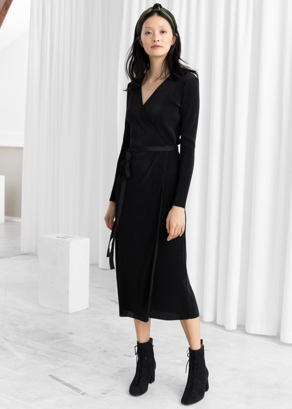 Model front image of Stories plissé pleated wrap dress in black