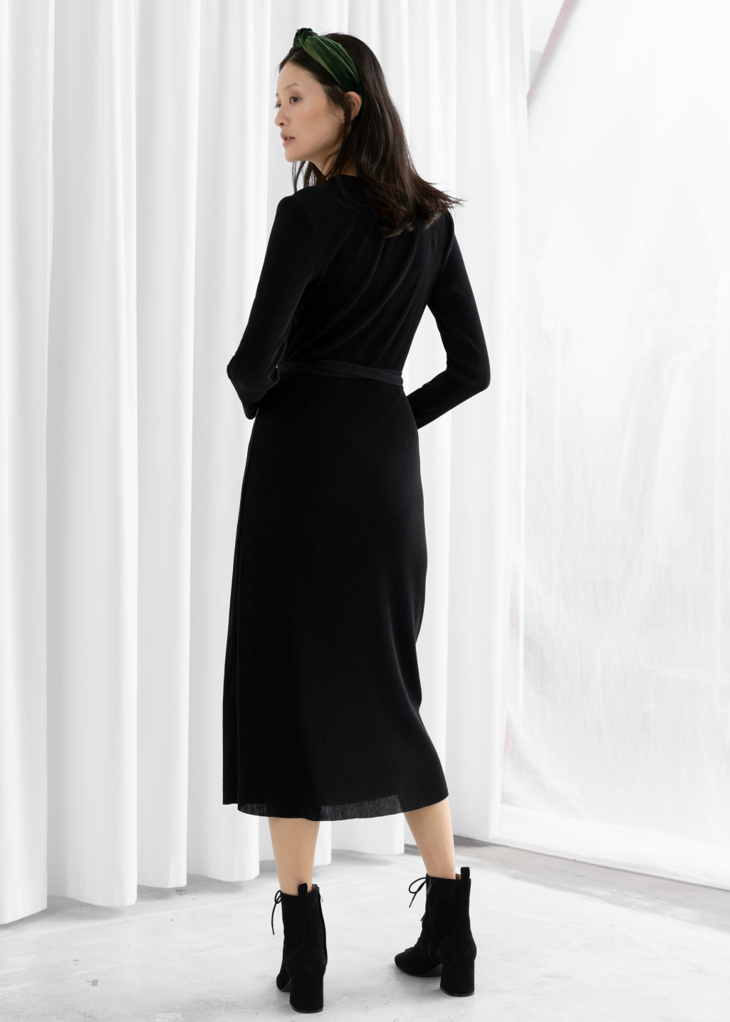 Model back image of Stories plissé pleated wrap dress in black