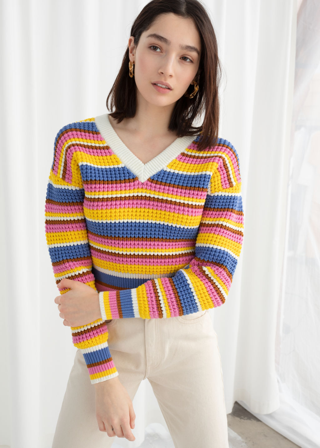 Model front image of Stories cropped striped cotton blend sweater in white
