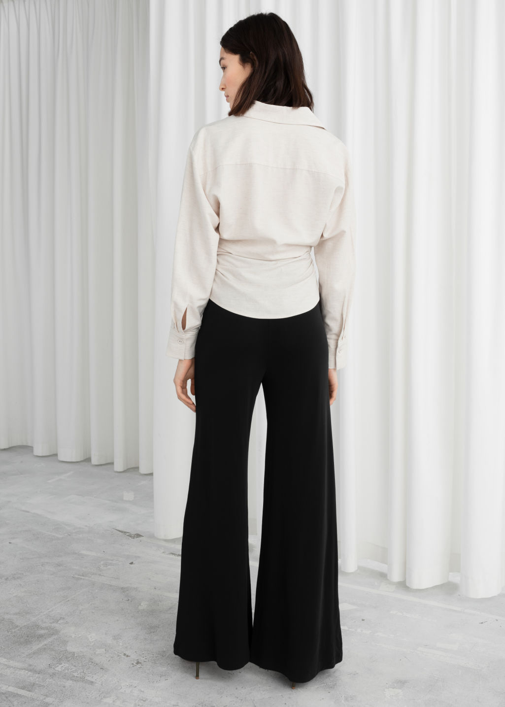 Model back image of Stories high waisted flared trousers in black