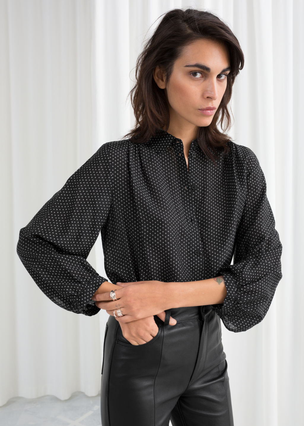 Model front image of Stories printed balloon sleeve blouse in black