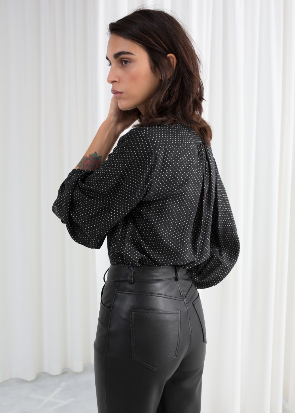 Model back image of Stories printed balloon sleeve blouse in black